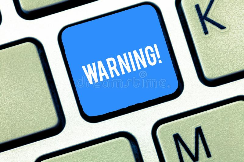 Handwriting text writing Warning. Concept meaning statement or event that warns of something or serves as example. Keyboard key Intention to create computer royalty free stock images