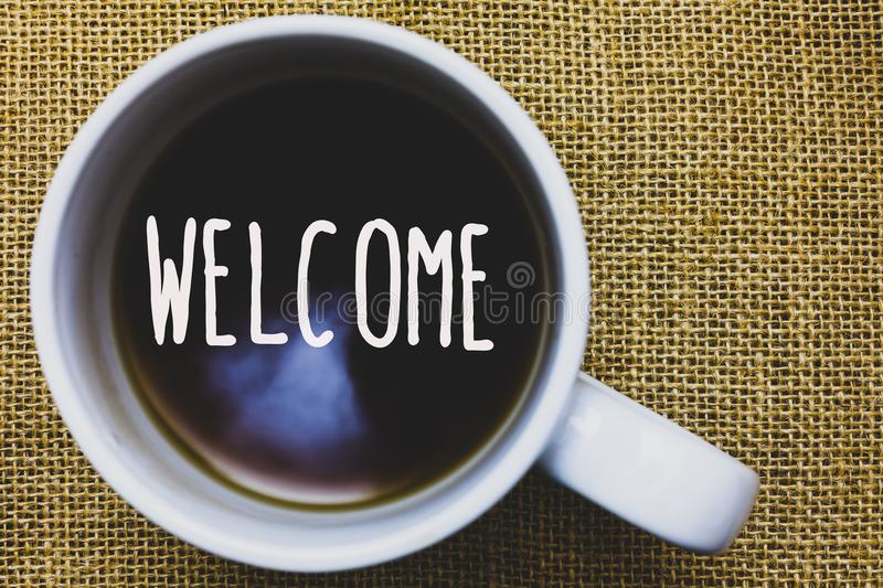 Handwriting text writing Welcome. Concept meaning Warm salutation acknowledgement for someone amiable loved thanked Mug coffee tho. Ughts ideas creative royalty free stock photos