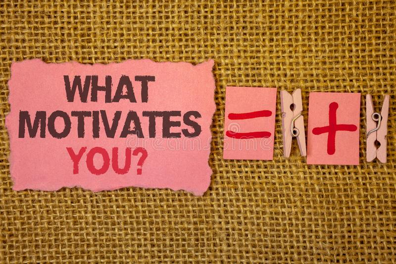 Handwriting text writing What Motivates You Question. Concept meaning Passion Drive Incentive Dream Aspiration Jute sacks plus two. Paper clip equal pink paper stock photos