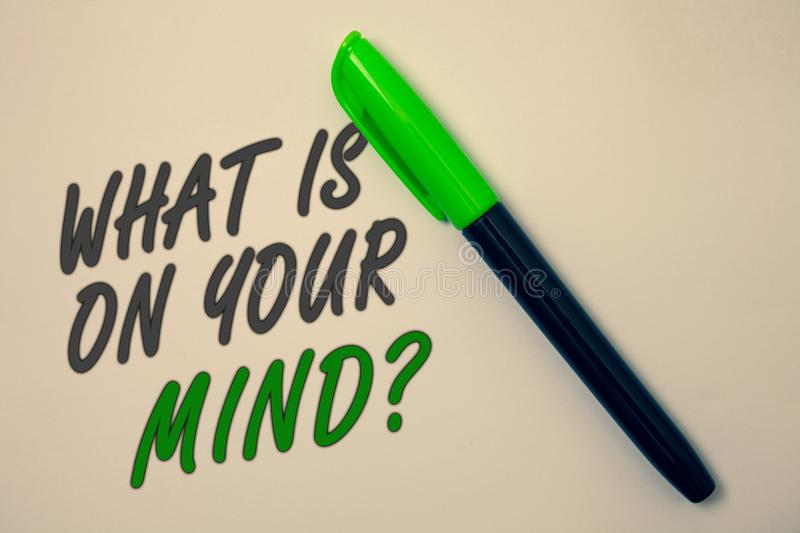 Handwriting text writing What Is On Your Mind Question. Concept meaning Open minded thinks of intellectual innovation Ideas messag. E beige background green pen stock photos