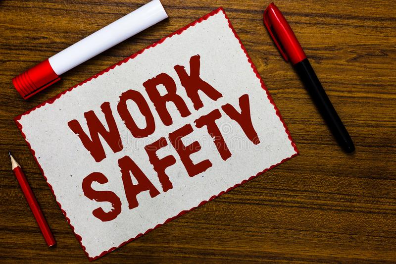 Handwriting text writing Work Safety. Concept meaning Policies and control in place according to government standard White paper r stock image
