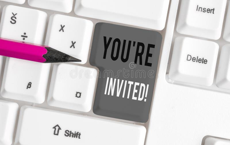 Handwriting text You Re Invited. Concept meaning make a polite friendly request to someone go somewhere White pc. Handwriting text You Re Invited. Conceptual royalty free stock photo