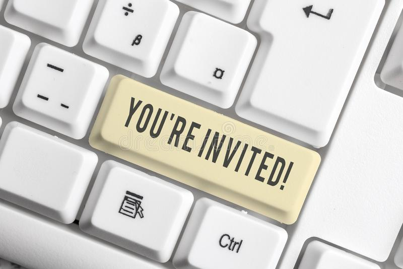 Handwriting text You Re Invited. Concept meaning make a polite friendly request to someone go somewhere White pc. Handwriting text You Re Invited. Conceptual stock images