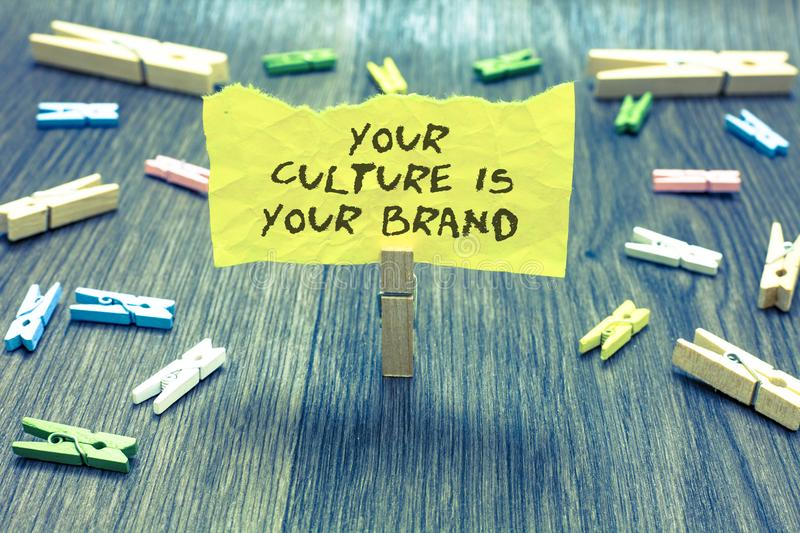 Handwriting text Your Culture Is Your Brand. Concept meaning Knowledge Experiences are a presentation card Paperclip hold written. Torn page many clips laid on royalty free stock photos