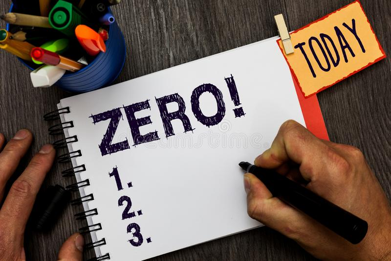 Handwriting text Zero. Concept meaning no quantity or number nought Nothing None Origin point on sketch Man holding. Marker notebook clothespin hold reminder stock photo