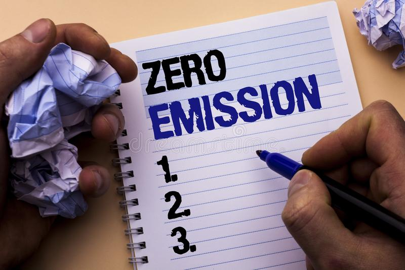 Handwriting text Zero Emission. Concept meaning Engine Motor Energy Source that emits no waste products written by Man on Notebook. Handwriting text Zero royalty free stock photography