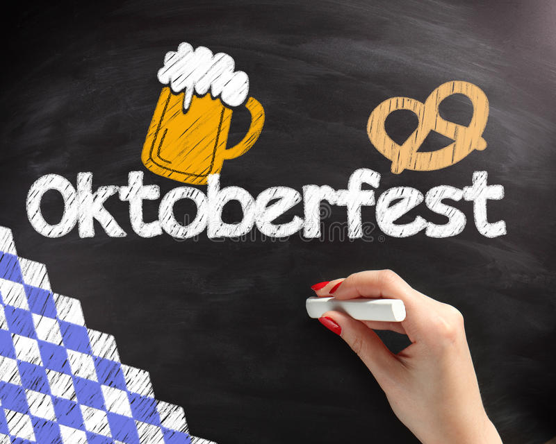 Handwritten Octoberfest Texts on Black Chalkboard. Handwritten Octoberfest Texts with Beer and Pretzel Drawing Design on Black Chalkboard royalty free stock images