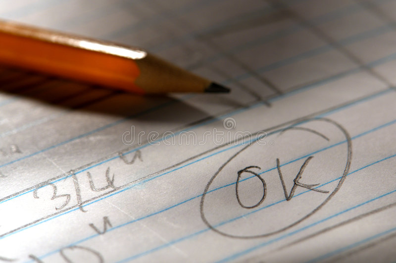 Handwritten OK Mark on a Drawing with Pencil stock images