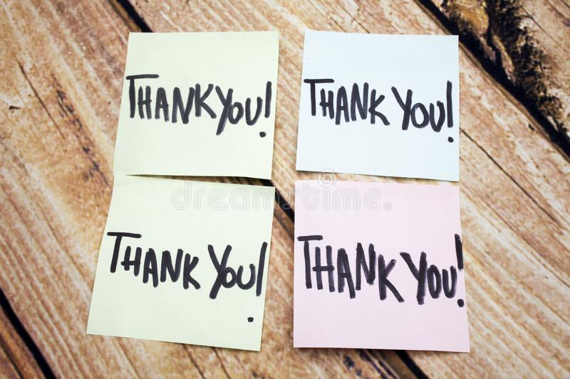 Handwritten Reminder of Gratitude. Positive Message About Values. Written Acknowledgement Response. Four Thank You Note. S on Paper. Expressing Acceptance royalty free stock image