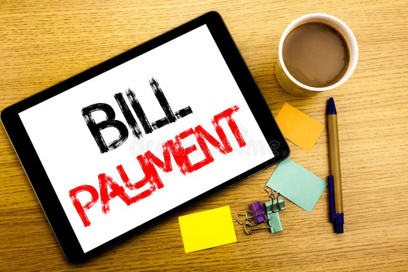 Handwritten text caption showing Bill Payment. Business concept writing for Billing Pay Costs Written on tablet laptop, wooden bac. Handwritten text caption stock images