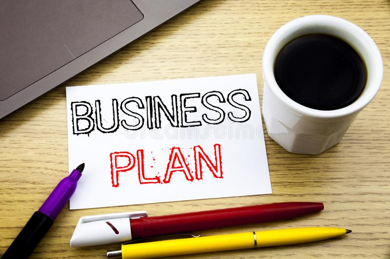 Handwritten text caption showing Business Plan Planning. Business concept writing for Preparation Project Strategy written on note. Book book on wooden royalty free stock image