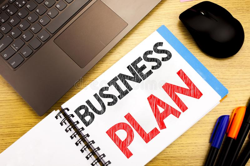 Handwritten text caption showing Business Plan Planning. Business concept writing for Preparation Project Strategy written on note. Pad with space on old wood stock image