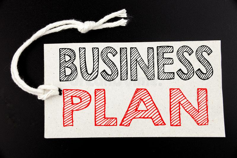 Handwritten text caption showing Business Plan Planning. Business concept writing for Preparation Project Strategy written on pric. E tag paper on black vintage stock photo