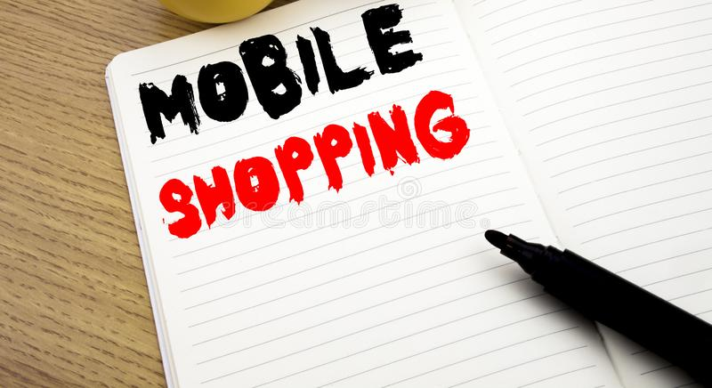 Handwritten text caption showing Mobile Shopping. Business concept writing for Cellphone online order written on notebook with cop. Handwritten text caption stock photography