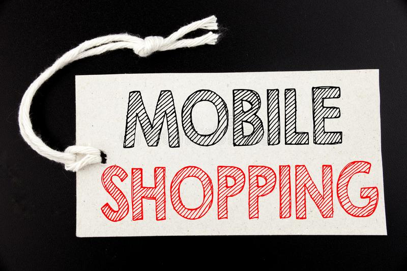 Handwritten text caption showing Mobile Shopping. Business concept writing for Cellphone online order written on price tag paper o. N black vintage background royalty free stock image
