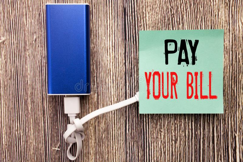 Handwritten text caption showing Pay Your Bill. Business concept writing for Payment for Goverment written on sticky note with cop. Handwritten text caption stock photos