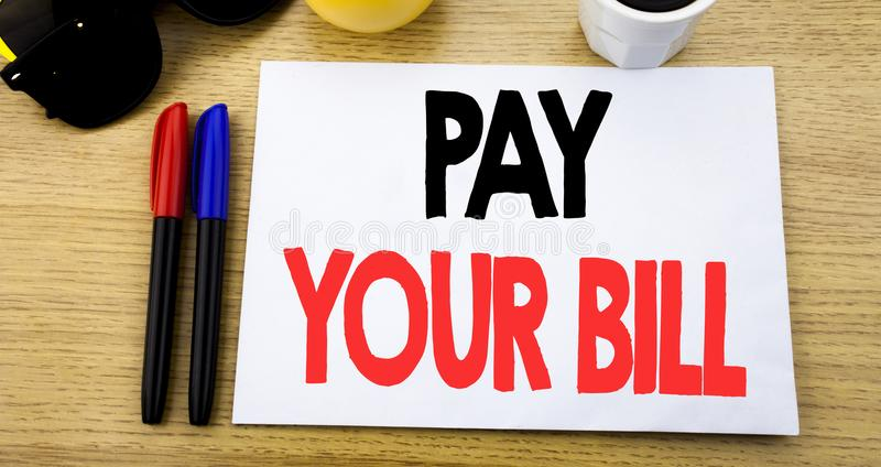 Handwritten text caption showing Pay Your Bill. Business concept writing for Payment for Goverment written on sticky note with cop. Y space old wood wooden royalty free stock image
