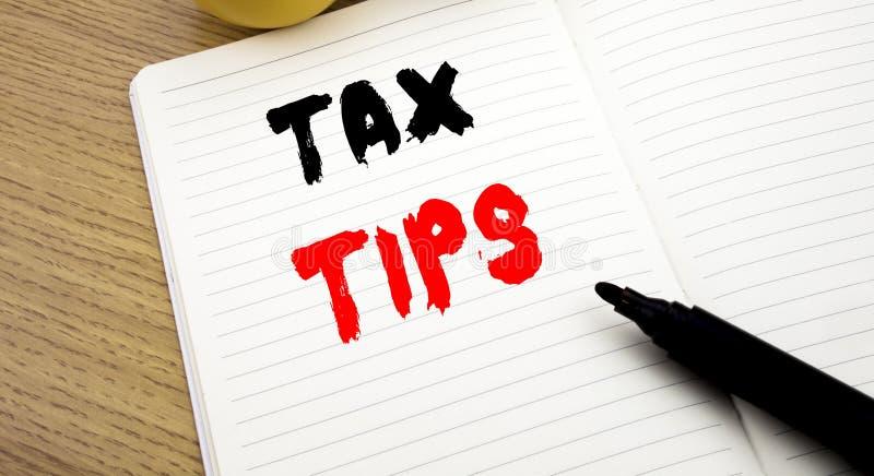 Handwritten text caption showing Tax Tips. Business concept writing for Taxpayer Assistance Refund Reimbursement written on notebo. Handwritten text caption stock images