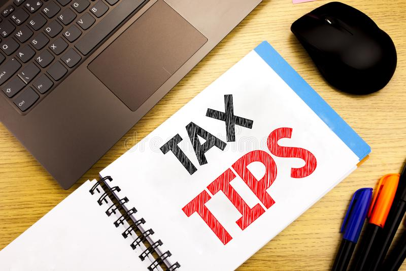 Handwritten text caption showing Tax Tips. Business concept writing for Taxpayer Assistance Refund Reimbursement written on notepa. D with space on old wood royalty free stock image