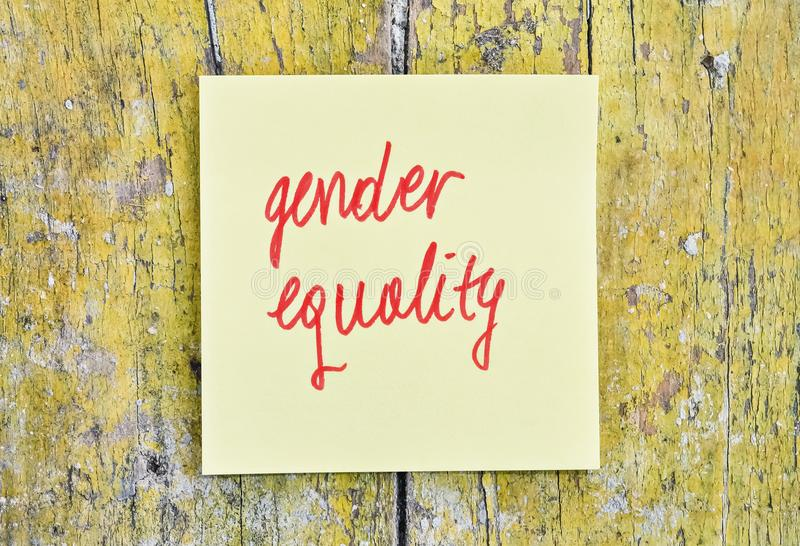 Text Gender Equality. Handwritten text Gender Equality on a sticker pinned on wooden background royalty free stock photography