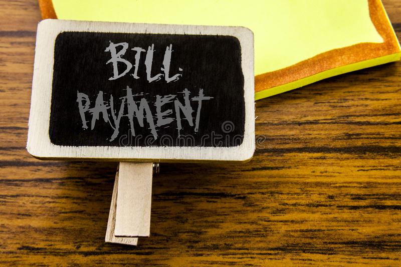 Handwritten text showing Bill Payment. Business concept for Billing Pay Costs written on announcement board on the wooden wood bac. Handwritten text showing Bill royalty free stock photo