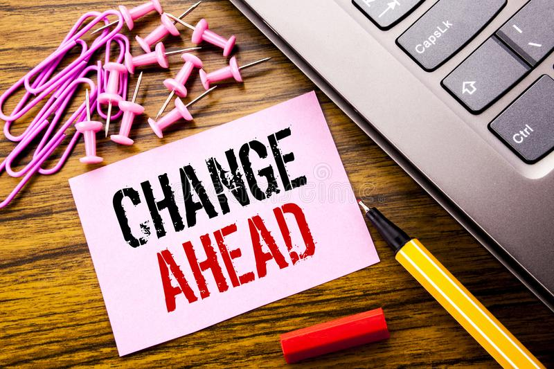 Handwritten text showing Change Ahead Red Word. Business concept for Future Changes written on pink sticky note paper on the woode royalty free stock photography