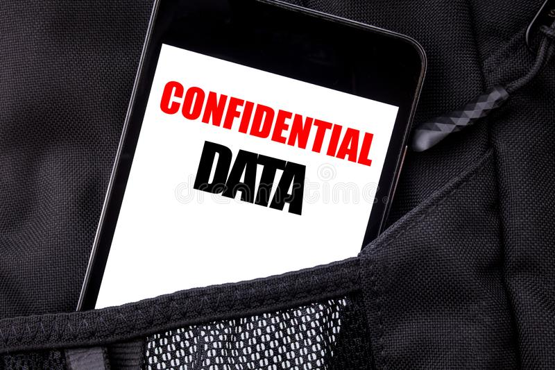 Handwritten text showing Confidential Data. Business concept writing for Secret Protection Written phone mobile phone, cellphone p. Laced in man front jeans royalty free stock images