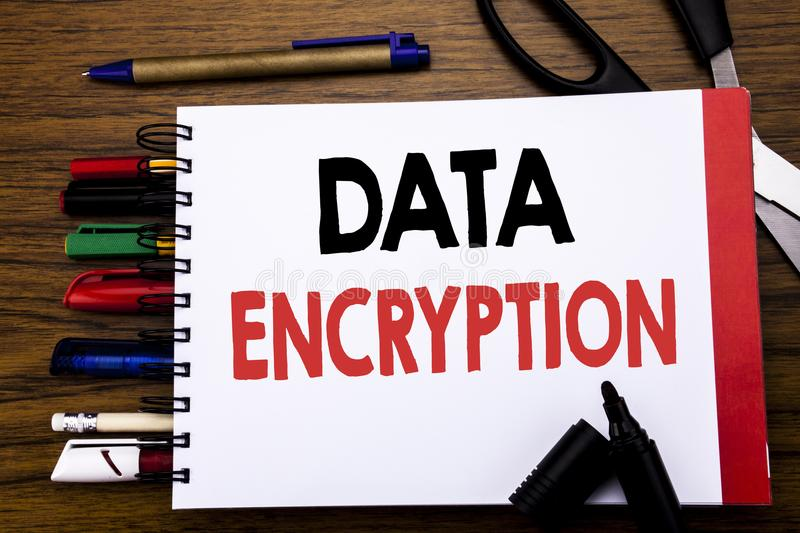 Handwritten text showing Data Encryption. Business concept for Information Security Written on notebook, wooden background with of. Handwritten text showing Data stock image