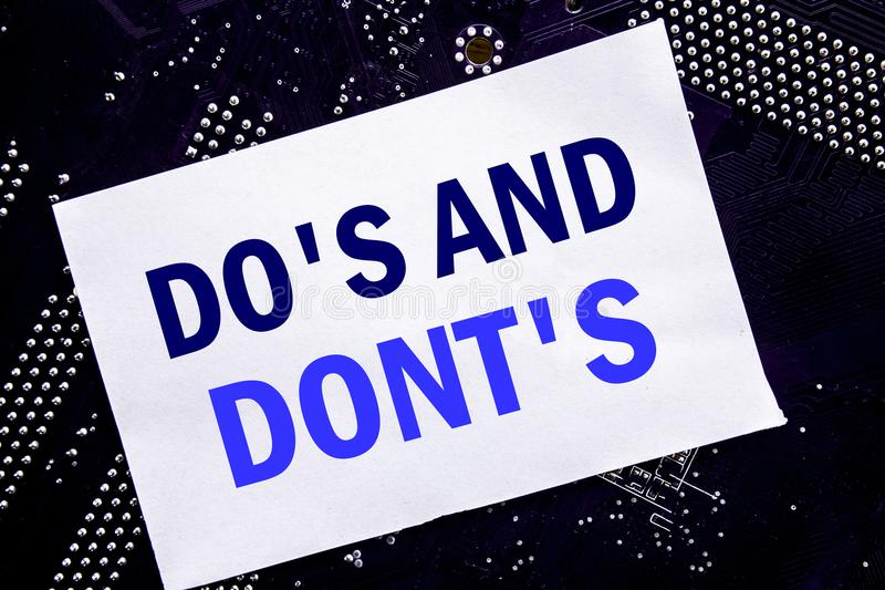 Handwritten text showing Do s And Do Not Donts. Business concept for Guide Allowed Written on sticky note, computer main board bac. Handwritten text showing Do s stock photos