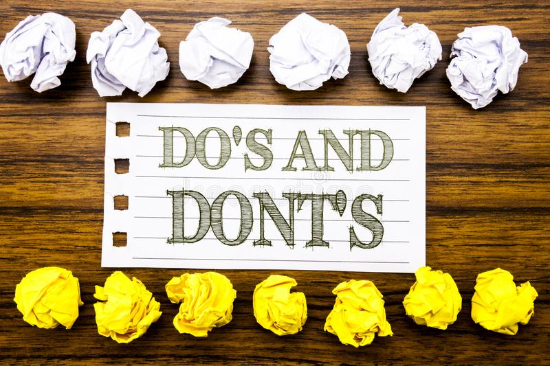 Handwritten text showing Do s And Do Not Donts. Business concept for Guide Allowed Written on sticky note, wooden with sticky, man. Handwritten text showing Do s stock photos