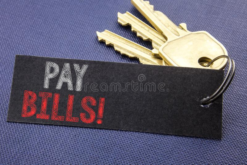 Handwritten text showing Pay Bills. Business concept writing for Finance Paying Online Written on note paper attached to the key,. Handwritten text showing Pay stock photography