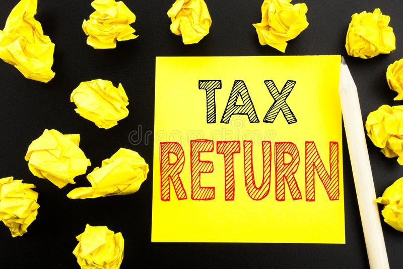 Handwritten text showing Tax Return. Business concept writing for Accounting Money Return written on sticky note paper on the blac. Handwritten text showing Tax royalty free stock photo