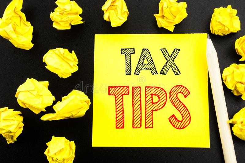 Handwritten text showing Tax Tips. Business concept writing for Taxpayer Assistance Refund Reimbursement written on sticky note pa. Per on black background royalty free stock images