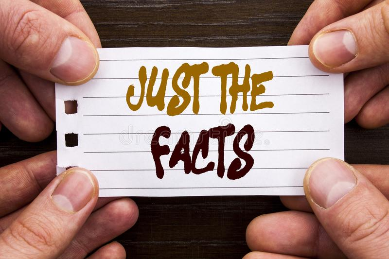 Handwritten text sign showing Just The Facts. Business concept for Truth Fact Accuracy Honest Concept For Factual Actual written. Sticky Note Paper Holding Hand royalty free stock image