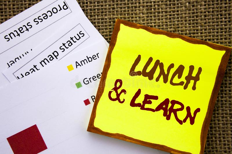 Handwritten text sign showing Lunch And Learn. Business concept for Presentation Training Board Course written on Sticky Note Pape. Handwritten text sign showing stock photo