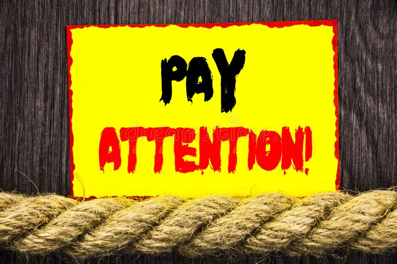 Handwritten text sign showing Pay Attention. Conceptual photo Be Careful Beware Mindful Alarm written on Sticky note next to the r. Handwritten text sign showing royalty free stock photos