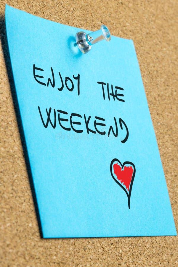 Handwritten wish to enjoy the weekend royalty free stock photos