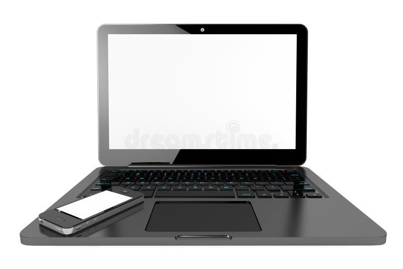 Handy über Laptop-Computer stockfotografie