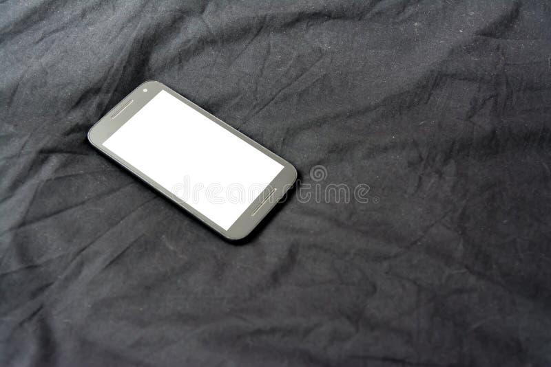 Handy auf schwarzem umfassendem weißem Schirm einfaches Backgro lizenzfreies stockfoto