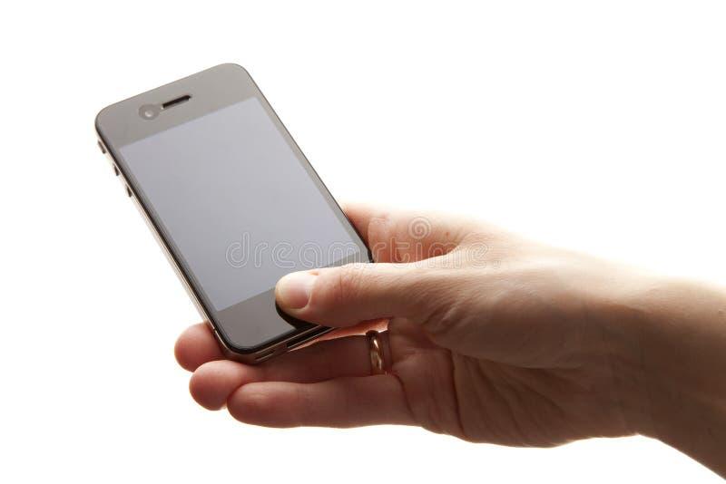 Handy in den Händen lizenzfreie stockbilder