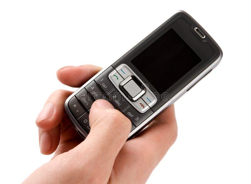 Handy in der Mannhand stockbild