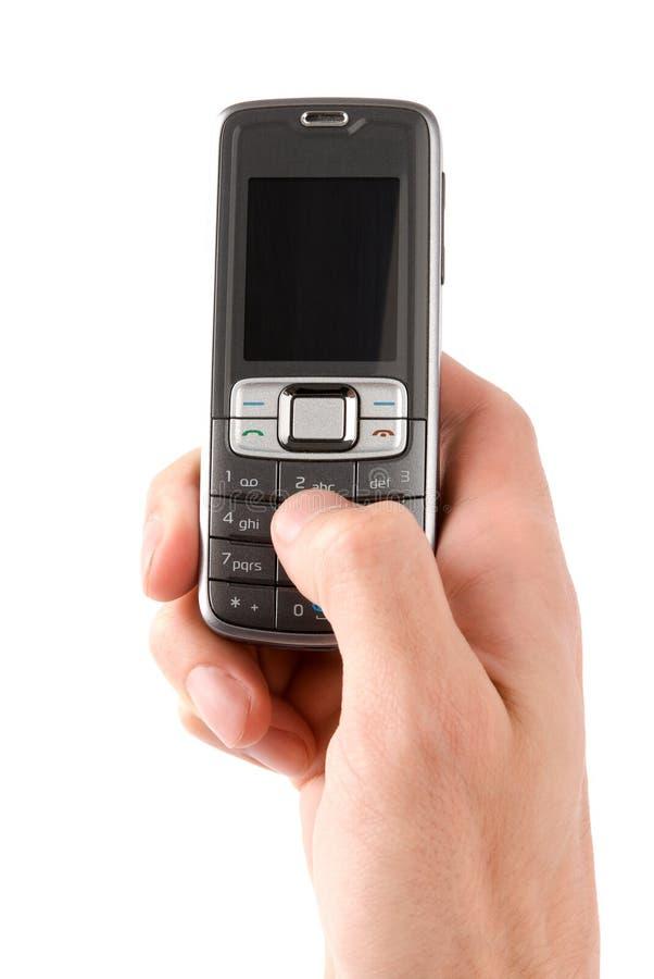 Handy in der Mannhand lizenzfreies stockfoto