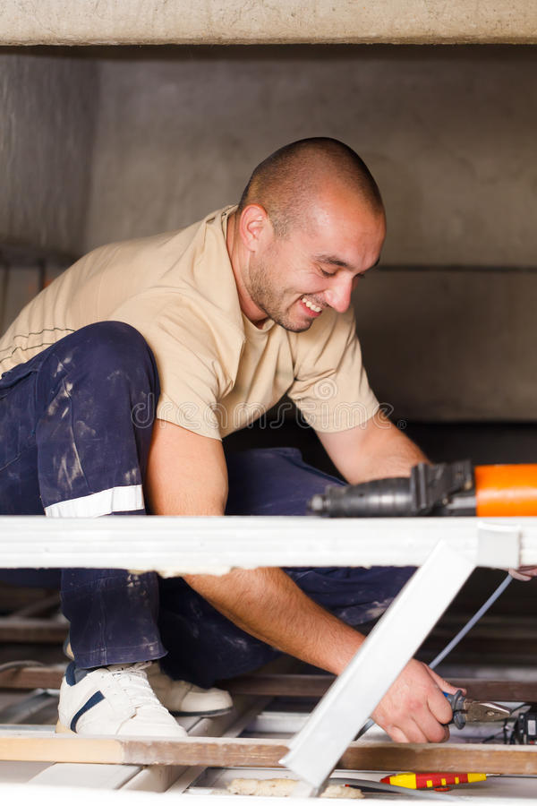 Handy Man Working With Cables royalty free stock images