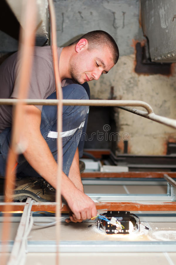 Handy Man Working With Cables royalty free stock photography