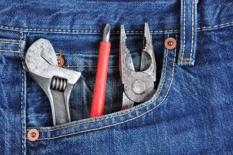 Handyman. Tools in the pocket of a handyman stock image