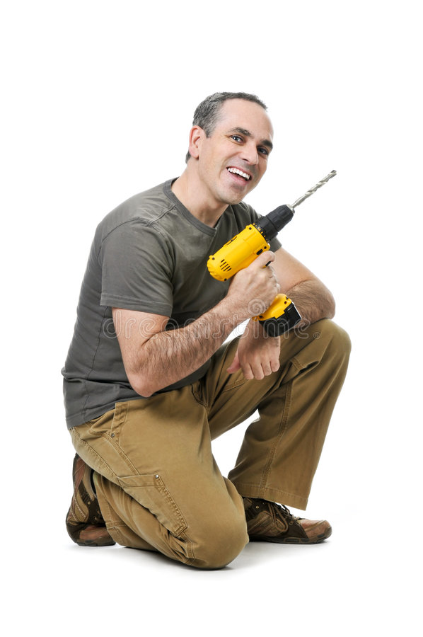 Handyman with a drill stock photo