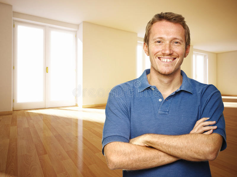Handyman in empty house royalty free stock photography