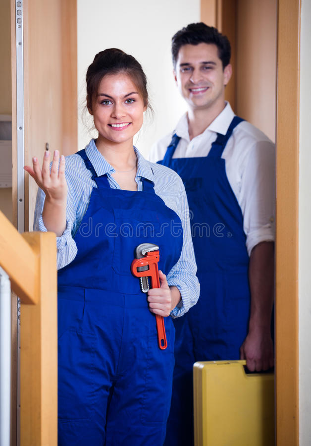 Handyman and female with tooling stock photography