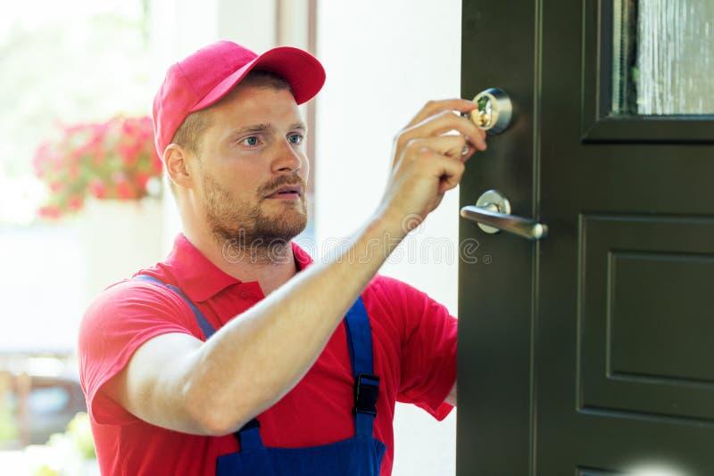 Handyman fixing house door lock stock photo