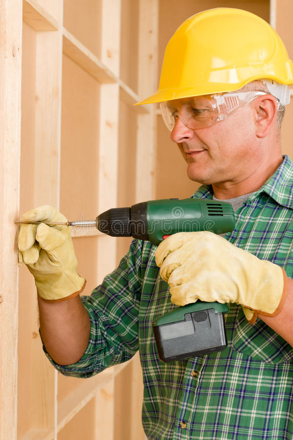 Handyman home improvement working with screwdriver royalty free stock photo